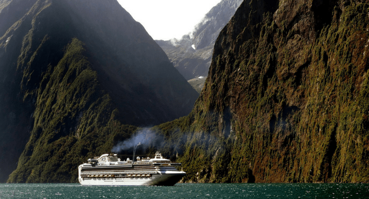 Cruise ship with mountains in the background